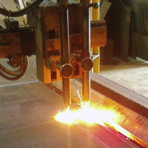 torches cutting thick steel plate