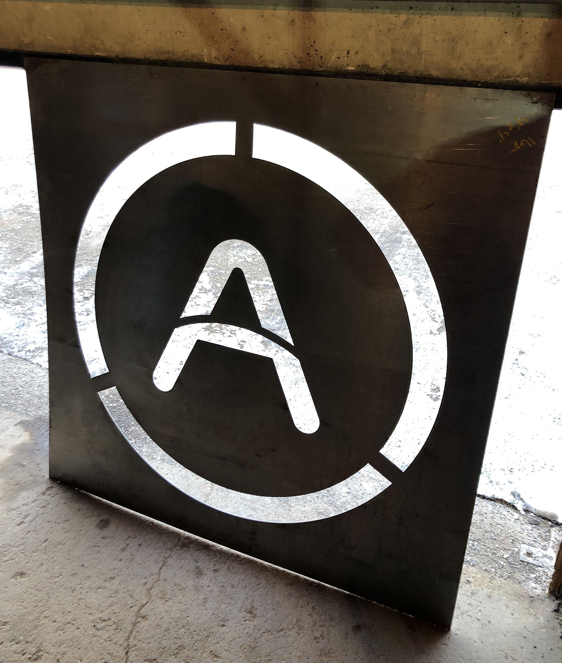 'A' logo cutout