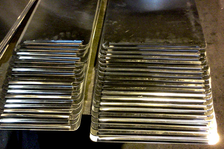 stack of formed aluminum plates