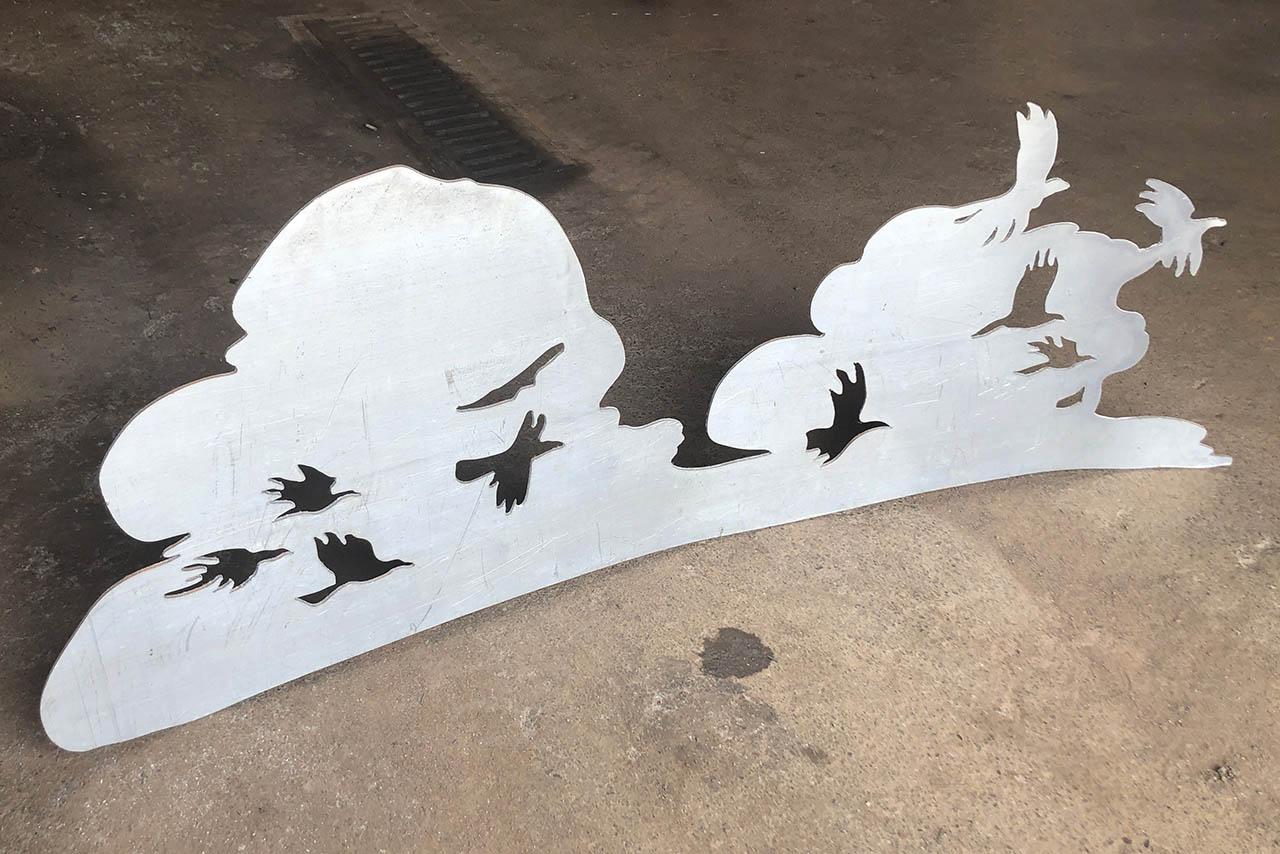 cloud and birds cut from aluminum