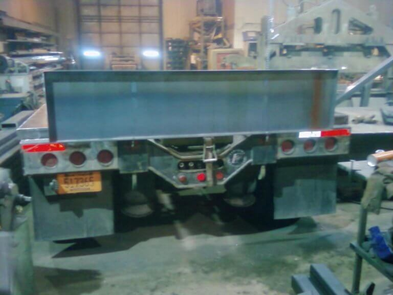 wide load sign on lowboy trailer